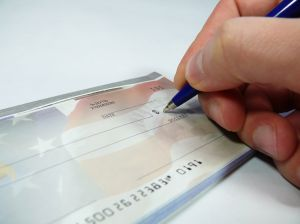 Company cheque or credit card used to purchase personal expenses