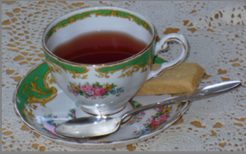 A bookkeeper's break - tea and shortbread served in Grandma's teacup!