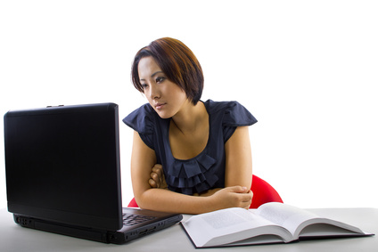 A small business owner taking an online bookkeeping course.