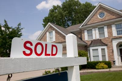 How do you record the sale of real estate when financing is provided?