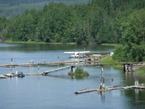 Image of seaplane moored on Stuart Lake. Life is good here.