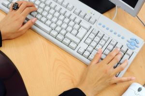 image of woman performing bookkeeping tasks on a computer courtesy of stock-xchng.com